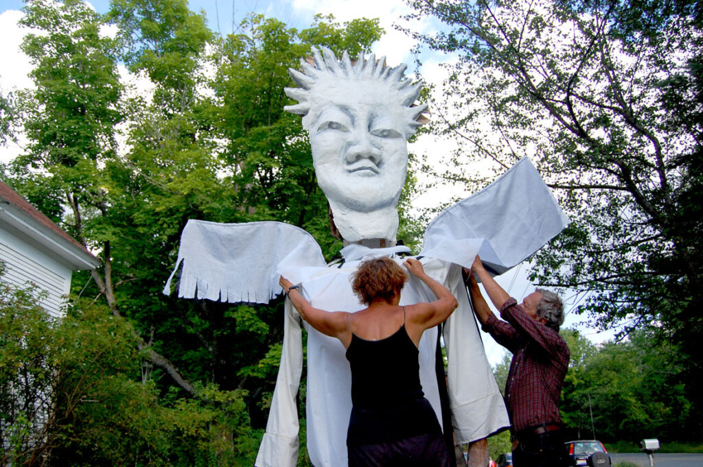Remi Paillard (right) and his partner Genevieve prepare a puppet at the Bread and Puppet farm, Glover, Vermont, Aug. 13, 2009. (©Greg Cook photo)