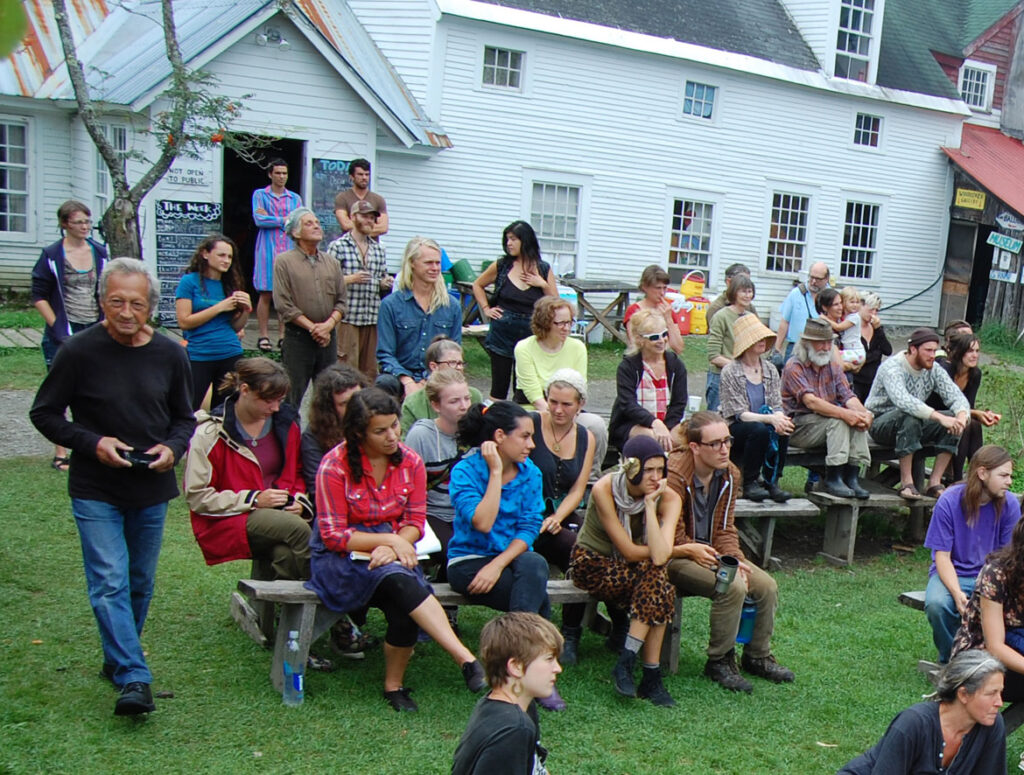Remi Paillard (left) photographs a rehearsal for the Bread and Puppet Circus, Glover, Vermont, Aug. 21, 2015. (©Greg Cook photo)