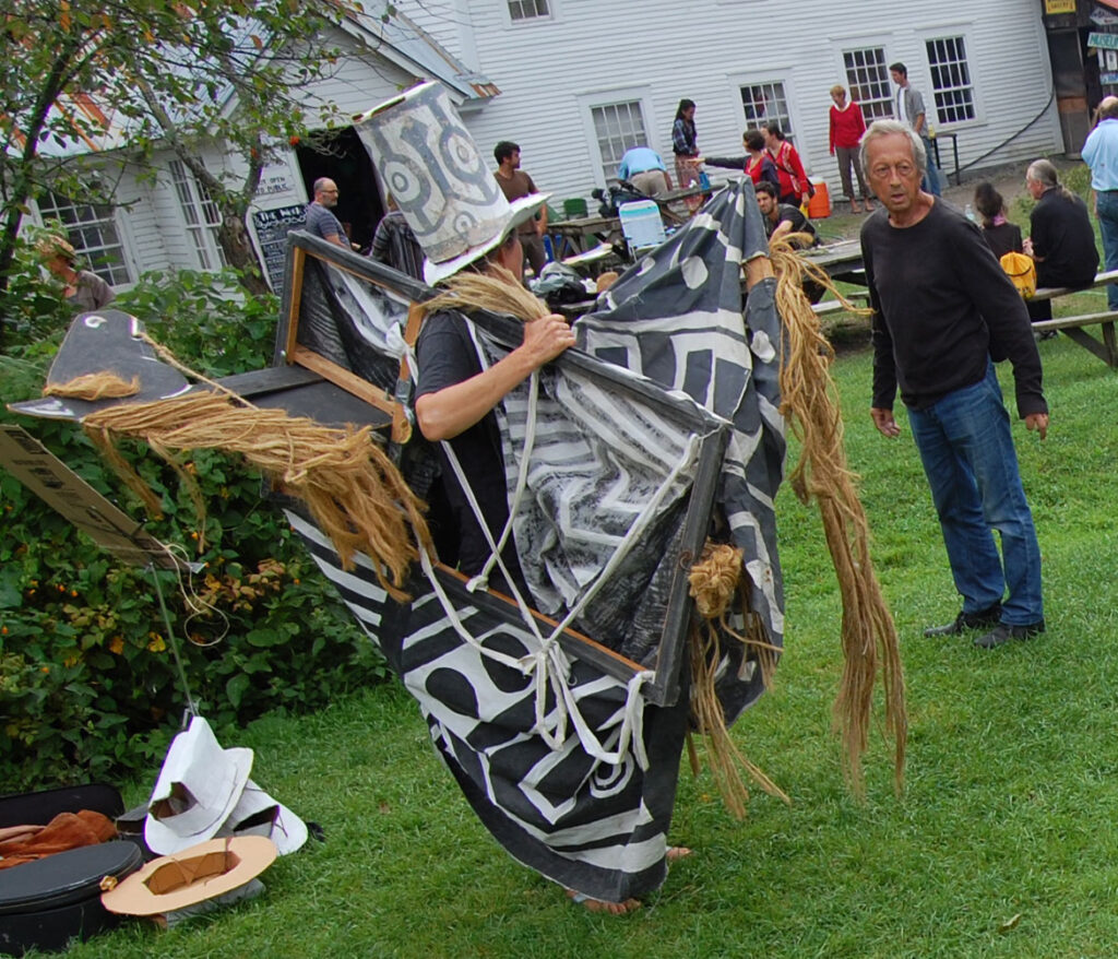 Remi Paillard (right) at a rehearsal for the Bread and Puppet Circus, Glover, Vermont, Aug. 21, 2015. (©Greg Cook photo)