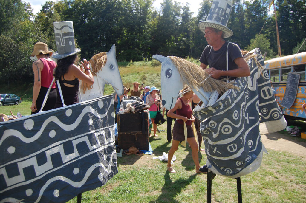 Remi Paillard (right) prepares to rehearse the Bread and Puppet Circus, Glover, Vermont, Aug. 22, 2015. (©Greg Cook photo)