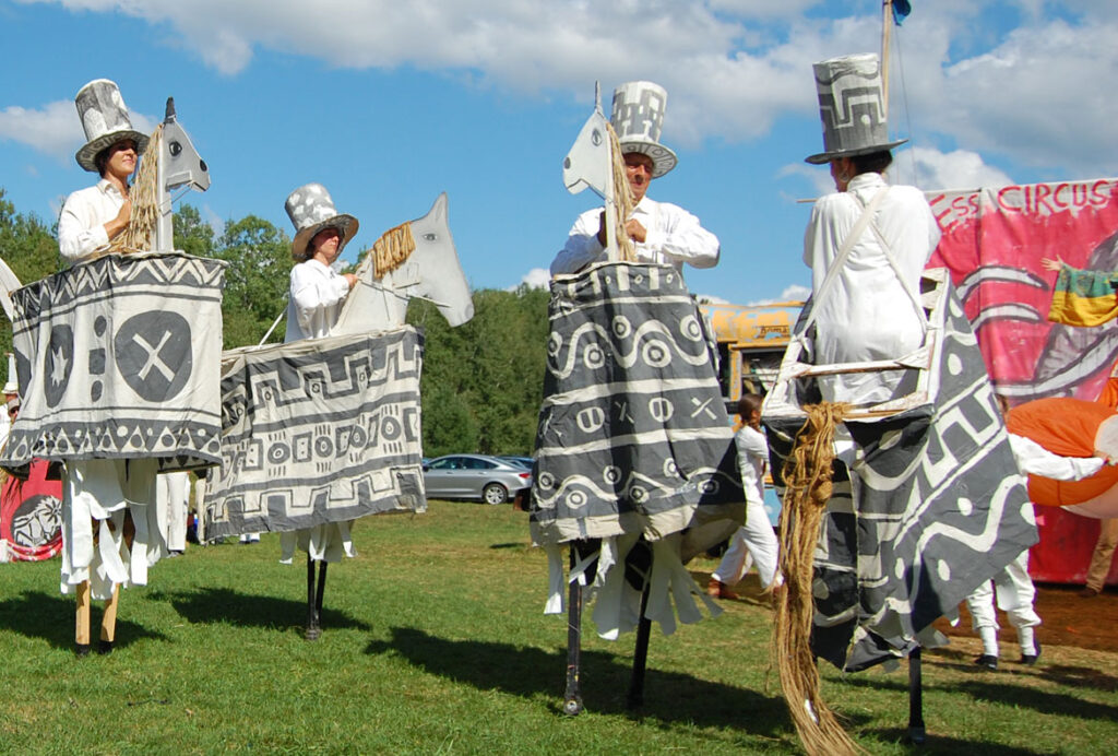 Remi Paillard (center) performs in the Bread and Puppet Circus, Glover, Vermont, Aug. 23, 2015. (©Greg Cook photo)