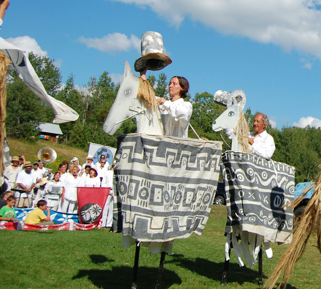 Remi Paillard (right) performs in the Bread and Puppet Circus, Glover, Vermont, Aug. 23, 2015. (©Greg Cook photo)