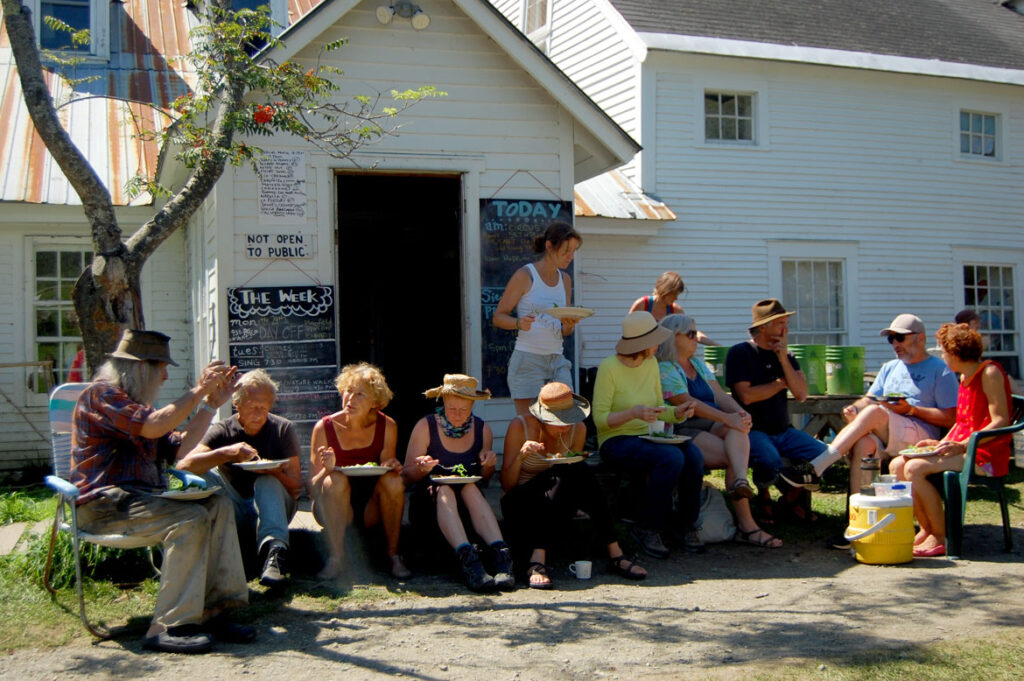 Remi Paillard (second from left) lunches with his partner Genevieve (right of him), Peter Schumann (left) and other puppeteers at the Bread and Puppet farm on a performance Sunday, Glover, Vermont, Aug. 22, 2015. (©Greg Cook photo)