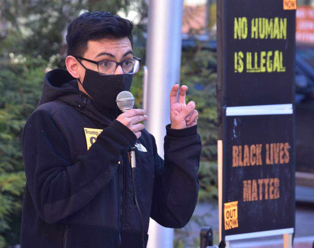 Diego Maldonado speaks at the Malden Rejects the Coup rally at Malden City Hall, Jan. 10, 2021. (©Greg Cook photo)