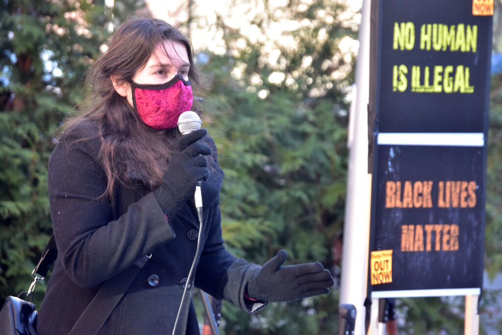 Anna Geoffroy speaks at the Malden Rejects the Coup rally at Malden City Hall, Jan. 10, 2021. (©Greg Cook photo)