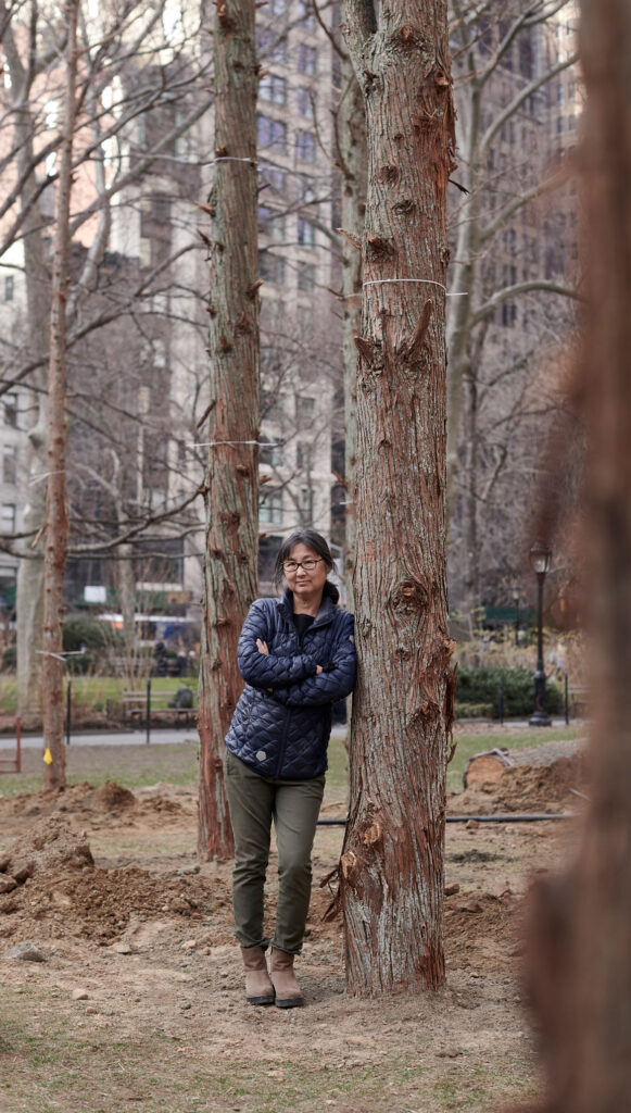 """Maya Lin in """"Ghost Forest,"""" 2021. (Courtesy the artist and Madison Square Park Conservancy / Photo credit: Andy Romer)"""