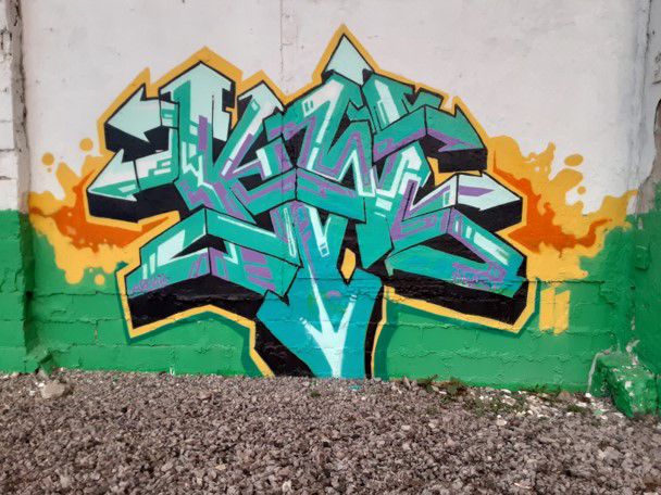 """Art by Kwest created at the """"Back Against the Wall: Graffiti in Grove Hall"""" event at Moses Auto in Boston's Dorchester neighborhood on May 15, 2021. (Courtesy Sobek)"""