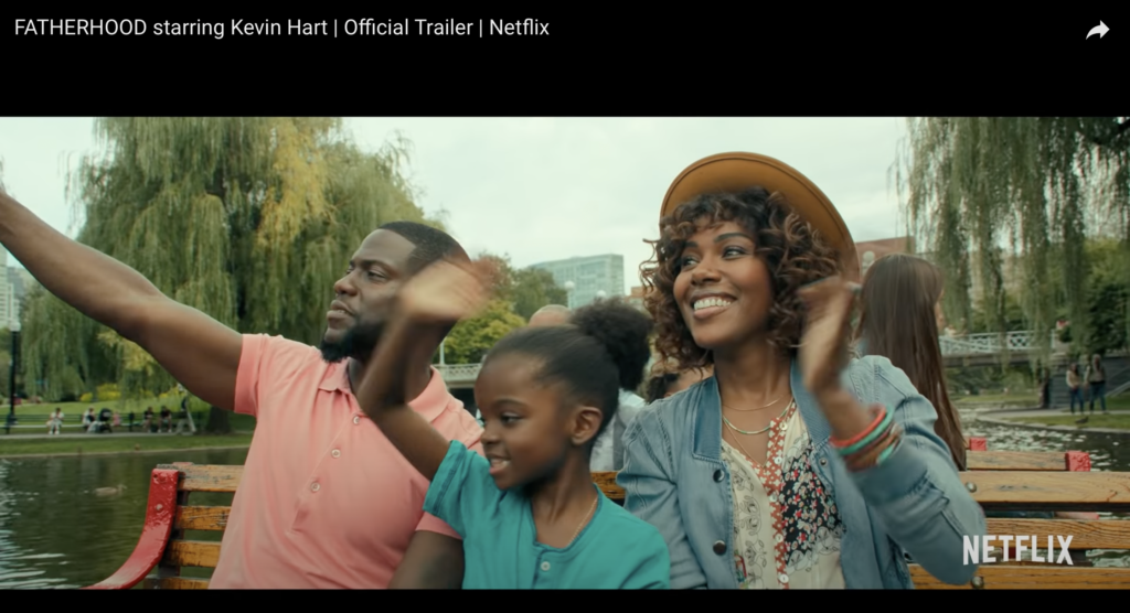 """Riding the Swan Boats at Boston's Public Garden in """"Fatherhood,"""" the 2021 Netflix movie starring Kevin Hart."""