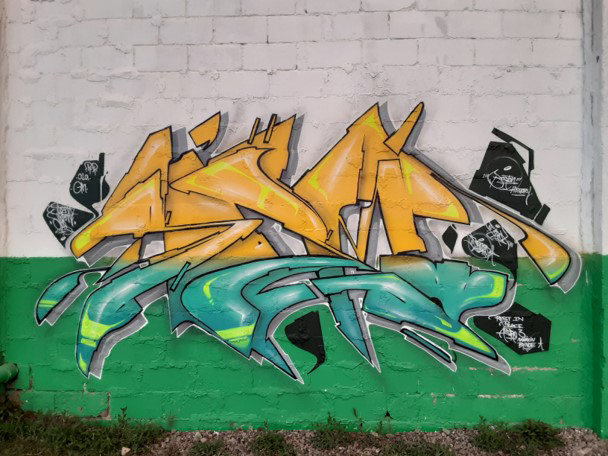 """Art by Soem created at the """"Back Against the Wall: Graffiti in Grove Hall"""" event at Moses Auto in Boston's Dorchester neighborhood on May 15, 2021. (Courtesy Sobek)"""
