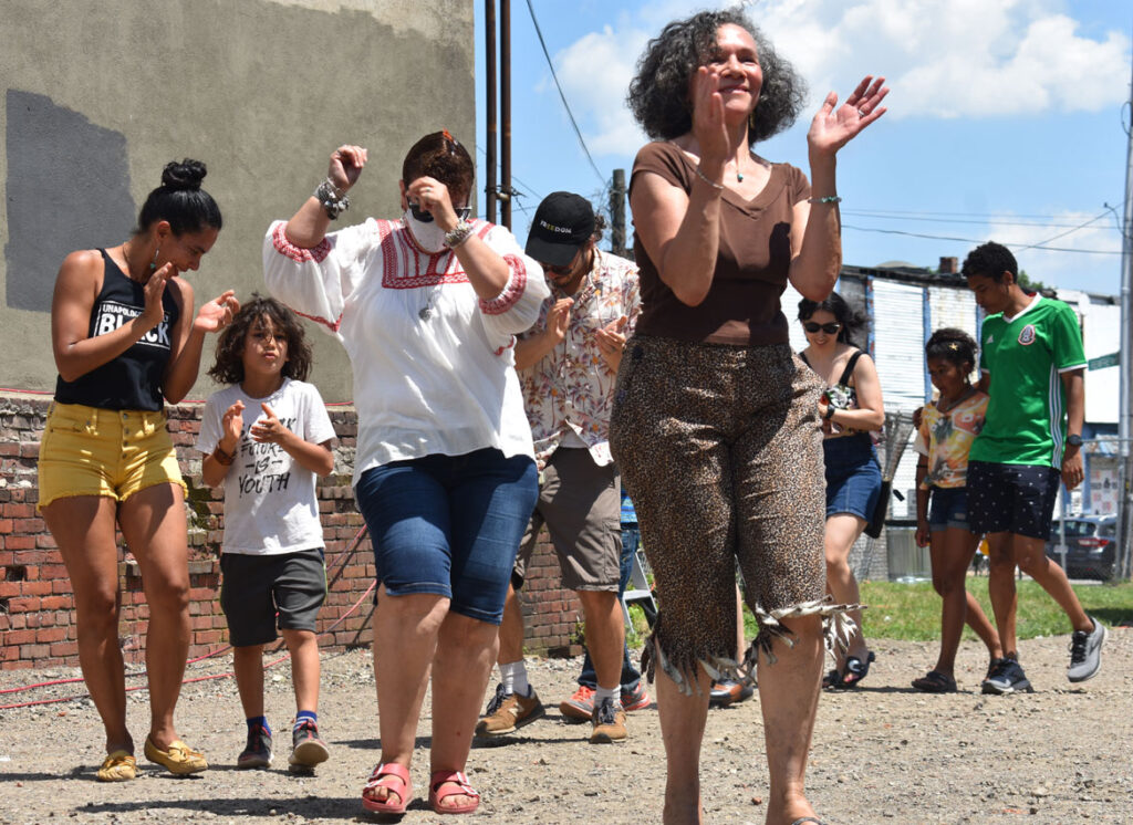 """Ring shout at Ife Franklin's Juneteenth Celebration at Black Market Nubian Square as part of the premiere of her film """"The Slave Narrative of Willie Mae,"""" June 19, 2021. (©Greg Cook photo)"""