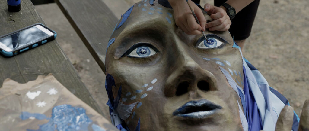 """From """"We Are Here"""" by Marc Levy and Marc Salomon of The Marcs: Painting a puppet for Paperhand Puppet Intervention's 2019 summer spectacle called """"We Are Here"""" in North Carolina. (Courtesy of The Marcs)"""