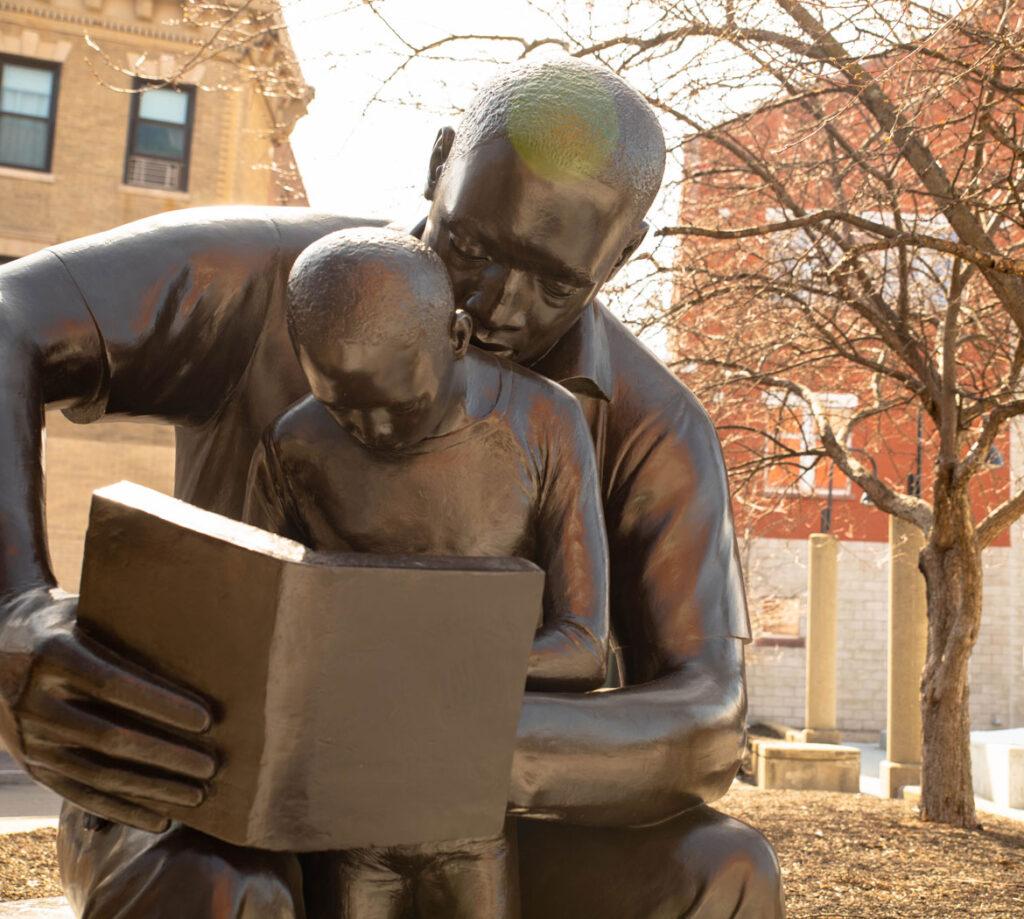 "John Wilson's sculpture ""Father and Child Reading,"" 1990, at Roxbury Community College, Boston. (Courtesy Roxbury Community College)"