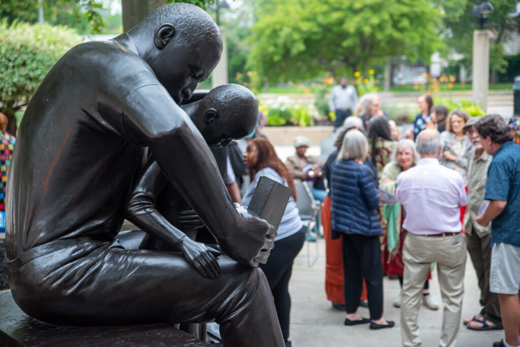"""At the rededication of John Wilson's sculpture """"Father and Child Reading,"""" 1990, at Roxbury Community College, Boston, July 13, 2021. (Courtesy Roxbury Community College)"""
