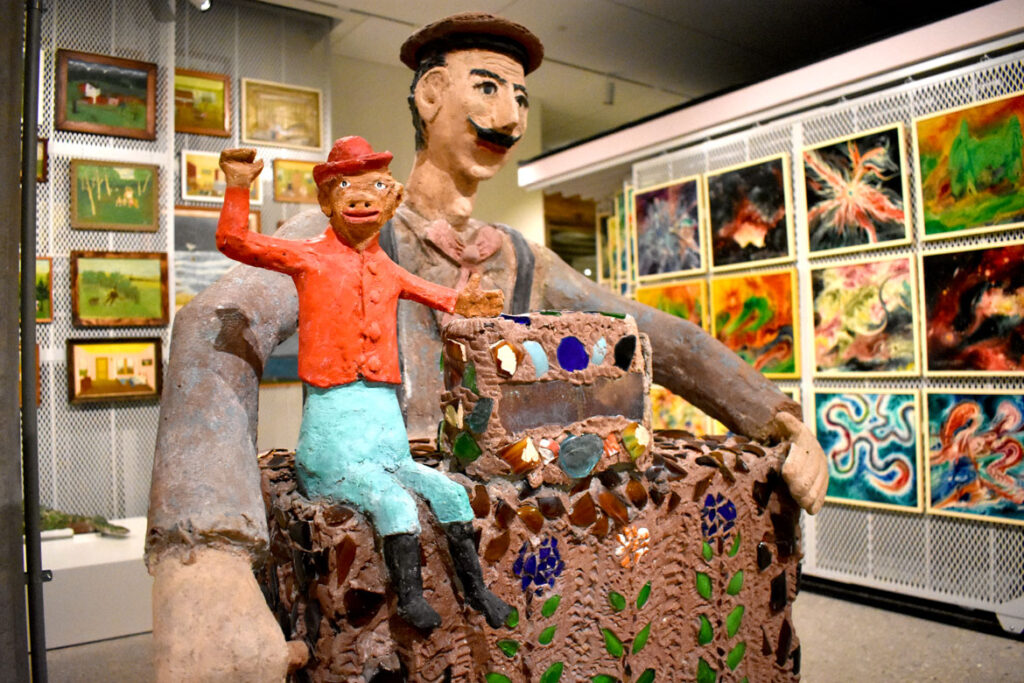 """Organ grider and monkey statue from Nick Engelbert's """"Grandview"""" at the Art Preserve of the Kohler Arts Center in Sheboygan, Wisconsin, July 2, 2021. (©Greg Cook photo)"""