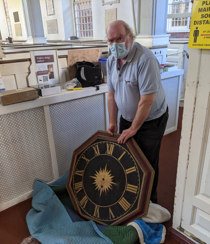 Ken Pearson holds the repaired 1726 Avery-Bennett clock at Boston's Old North Church on June 16, 2021. (Courtesy Old North Church & Historic Site)