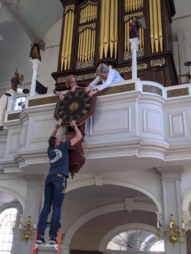 Re-installing the repaired 1726 Avery-Bennett clock at Boston's Old North Church on June 16, 2021. (Courtesy Old North Church & Historic Site)