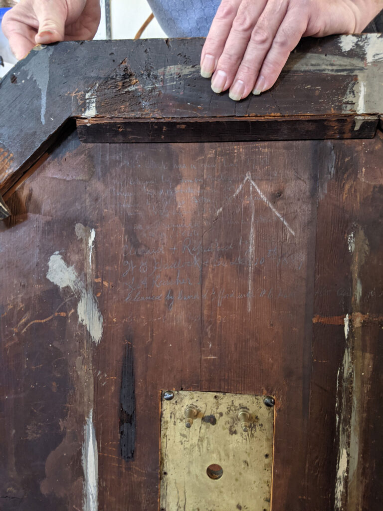A history of artisans who worked on or repaired the Old North Church's 1726 Avery-Bennett clock is written on the back. (Courtesy Old North Church & Historic Site)