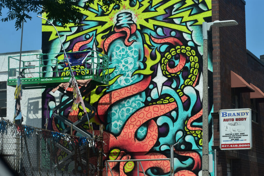 """Salem artist Tallboy's muarl at 160 Liverpool St., East Boston, for the """"Sea Walls"""" mural project, July 23, 2021. (©Greg Cook photo)"""