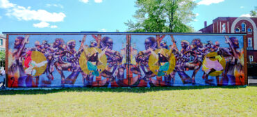 """Paul Goodnight and Larry Pierce's temporary, printed mural """"No Strings Detached"""" at Breeze's Laundromat, Grove Hall, Boston, 2021. (Courtesy Now + There)"""