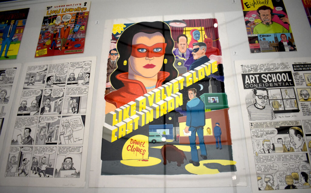 """Daniel Clowes comics, including the paperback cover of """"Like a Velvet Glove Cast in Iron,"""" 2017, gouache on board. In """"Chicago Comics"""" at Chicago's Museum of Contemporary Art, July 3, 2021. (©Greg Cook photo)"""