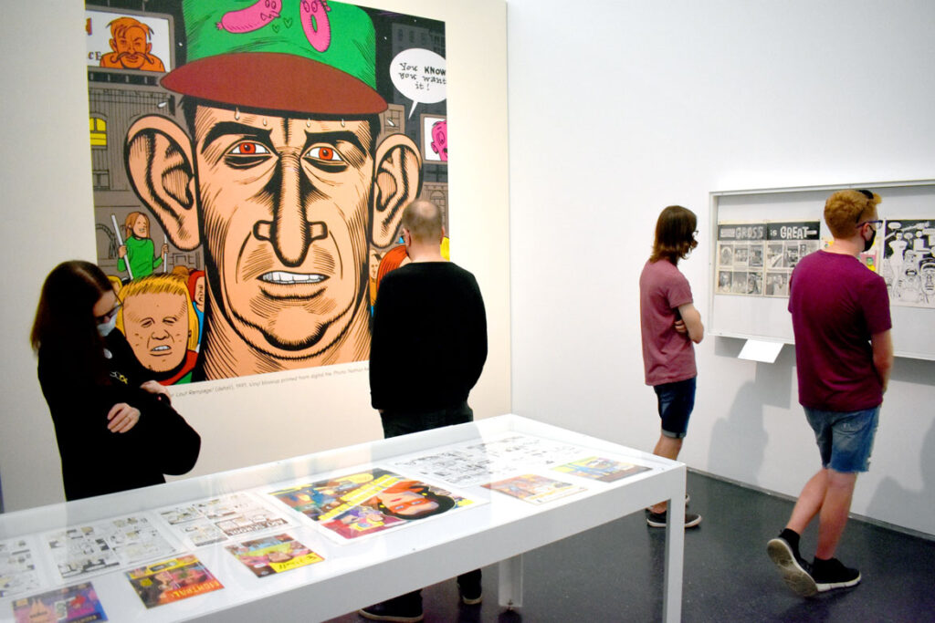 """Gallery with enlargement of the cover of Daniel Clowes's """"Lout Rampage!"""" 1991. In """"Chicago Comics"""" at Chicago's Museum of Contemporary Art, July 3, 2021. (©Greg Cook photo)"""