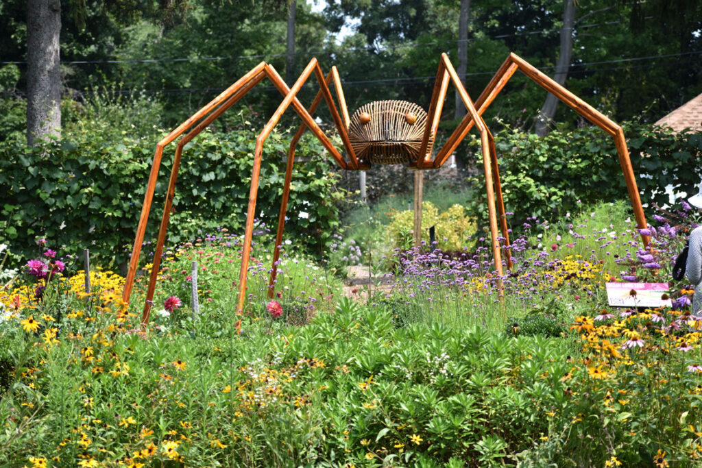 """""""Daddy Long Legs"""" in David Rogers's """"Big Bugs"""" at Green Animals Topiary Garden, Portsmouth, Rhode Island, August 2021. (©Greg Cook photo)"""