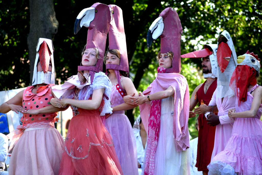 """Flamingos dance in Bread and Puppet Theater's """"Circus"""" at Cambridge Common, Sept. 4, 2021. (©Greg Cook photo)"""