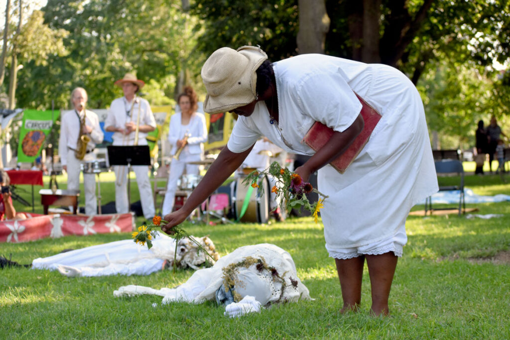 """Remembering the victims of the Tulsa, Oklahoma massacre of 1921 during Bread and Puppet Theater's """"Circus"""" at Cambridge Common, Sept. 4, 2021. (©Greg Cook photo)"""