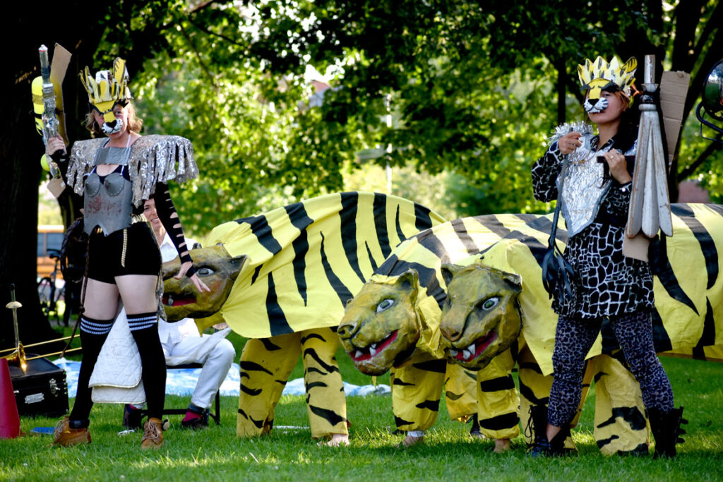 """Tigers on Mars during Bread and Puppet Theater's """"Circus"""" performance at Cambridge Common, Sept. 4, 2021. (©Greg Cook photo)"""