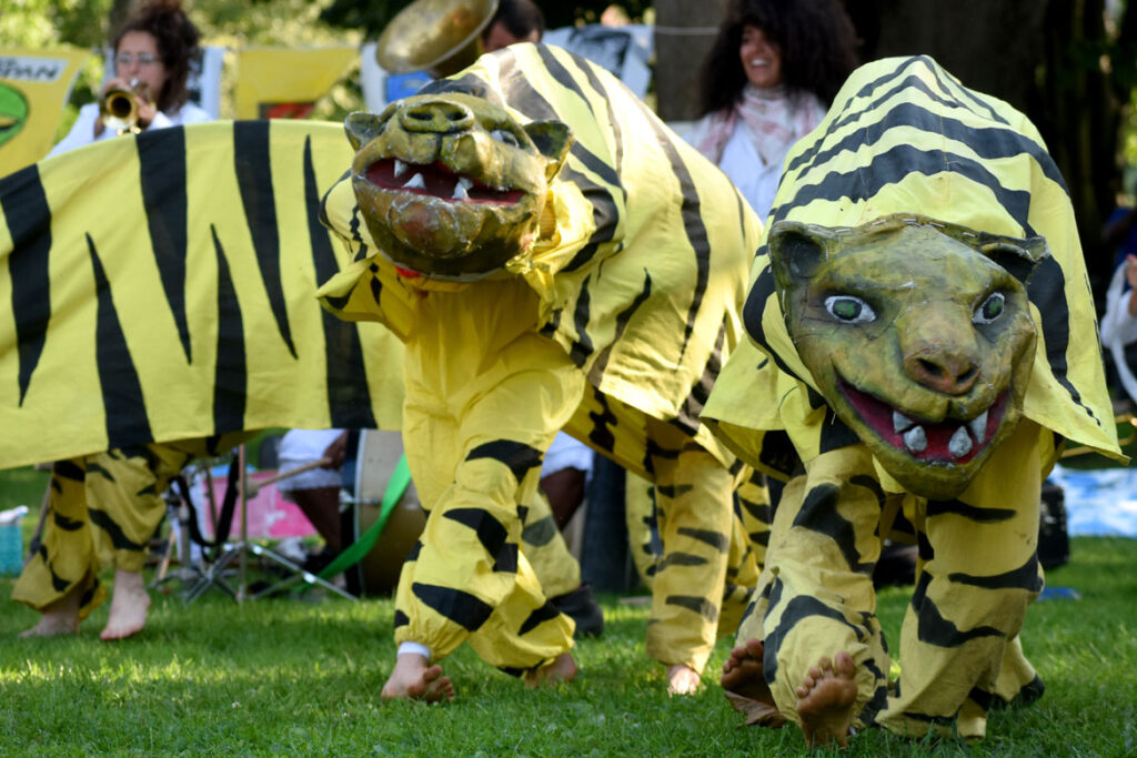 """Tigers prowl Bread and Puppet Theater's """"Circus"""" performance at Cambridge Common, Sept. 4, 2021. (©Greg Cook photo)"""