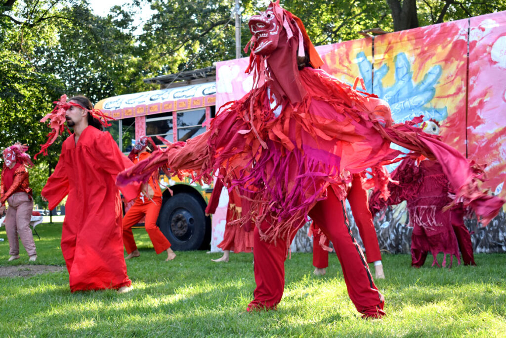 """Climate Change """"Code Red"""" scene in Bread and Puppet Theater's """"Circus"""" performed at Cambridge Common, Sept. 4, 2021. (©Greg Cook photo)"""