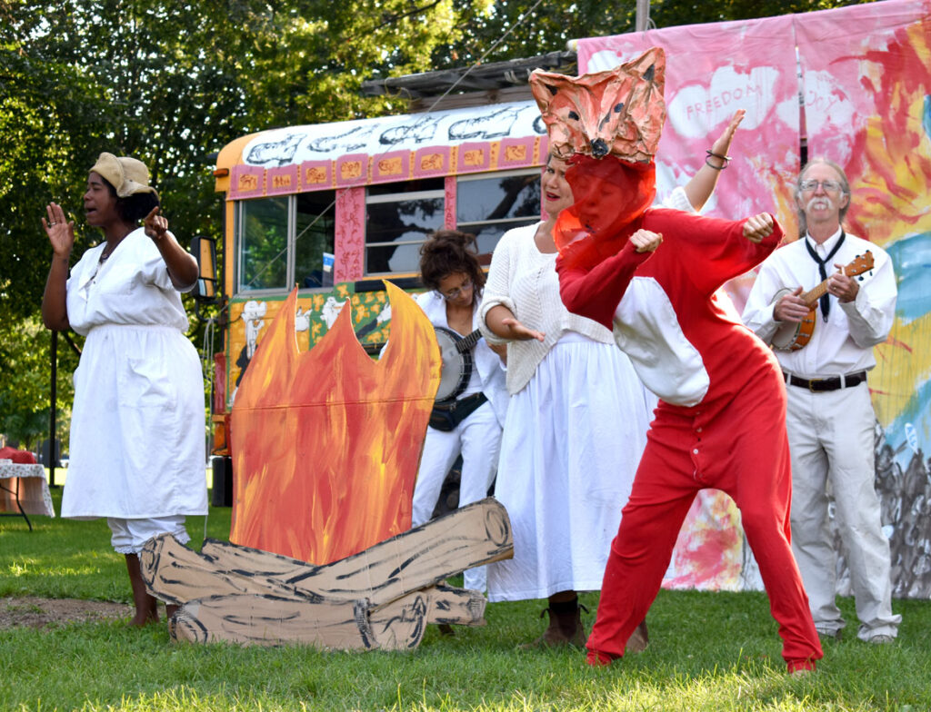 """A fox """"that ruined a fracking site with its poop"""" in Bread and Puppet Theater's """"Circus"""" at Cambridge Common, Sept. 4, 2021. (©Greg Cook photo)"""