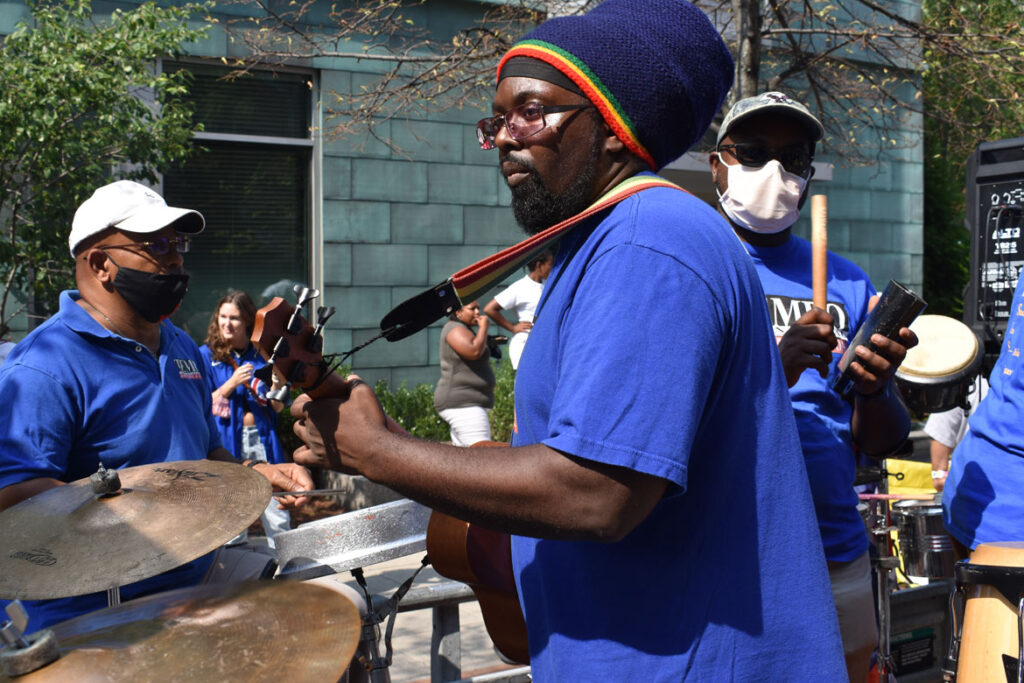 Tempo International Rhythm Section performs in the Cambridge Carnival parade, Sept. 12, 2021. (©Greg Cook photo)