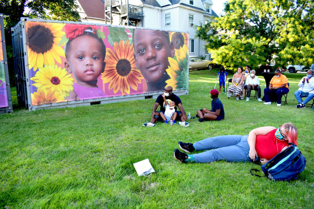 """Ekua Holmes and London Parker-McWhorter's temporary, printed murals """"Honoring the past, seeding the future,"""" at Breeze's Laundromat at 345 Blue Hill Ave., Boston, Sept. 8, 2021. (©Greg Cook Photo)"""