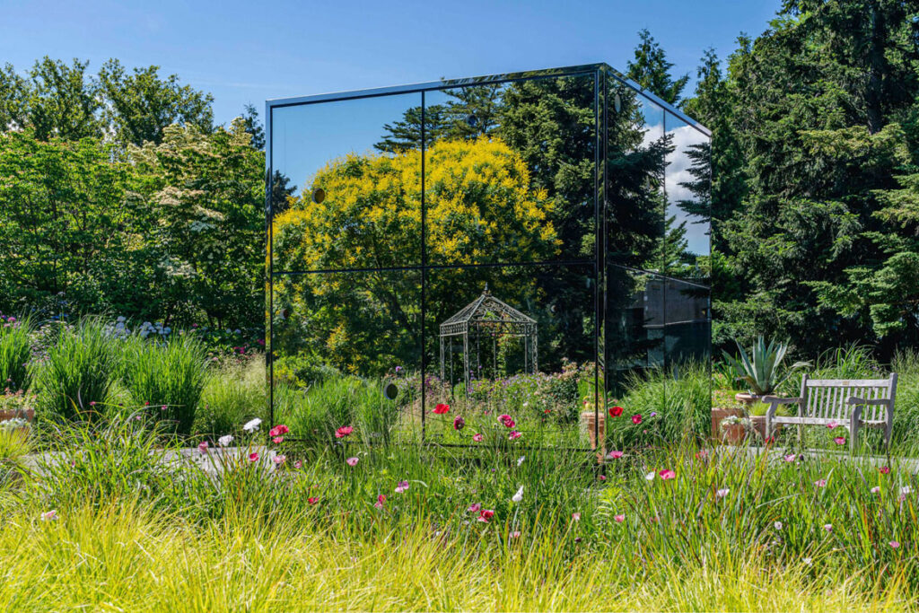 """Yayoi Kusama, """"Infinity Mirrored Room—Illusion Inside the Heart,"""" 2020, at The New York Botanical Garden, 2021. Mirror-polished stainless steel, glass mirrors, and colored glass. (Courtesy of Ota Fine Arts, Victoria Miro, and David Zwirner)"""