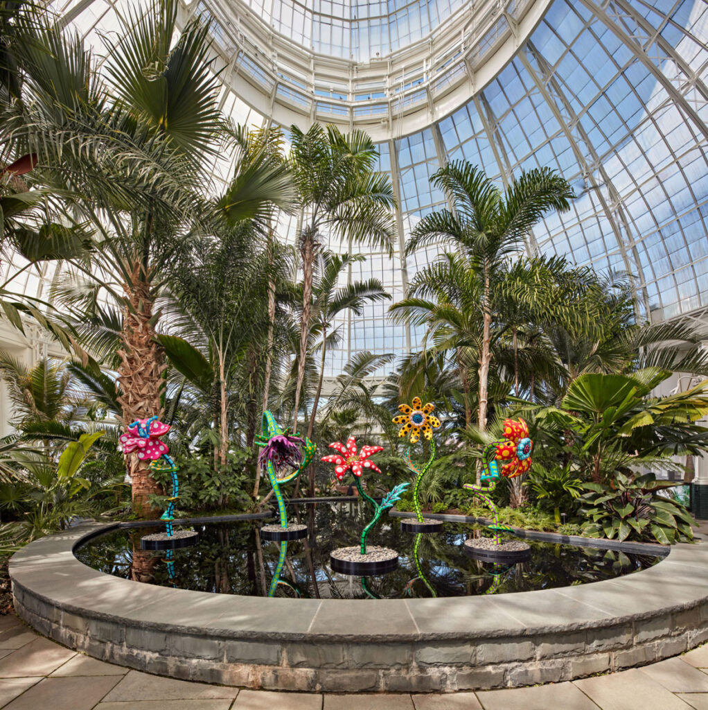 """Yayoi Kusama, """"My Soul Blooms Forever,"""" 2019, at The New York Botanical Garden, 2021. Urethane paint on stainless steel. (Courtesy of Ota Fine Arts, Victoria Miro, and David Zwirner. Photo by Robert Benson Photography.)"""