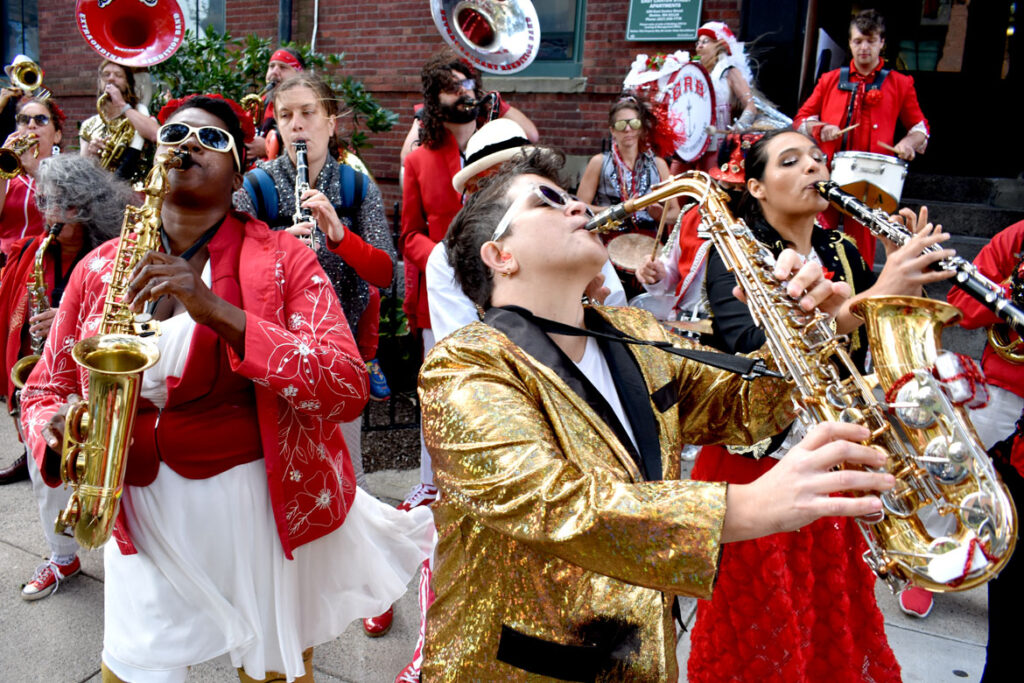 Extraordinary Rendition Band performs at a rally to oppose luxury development and support affordable housing, in collaboration with the Mass Alliance of HUD Tenants, on east Canton Street, Boston, Oct. 9, 2021. (©Greg Cook photo)