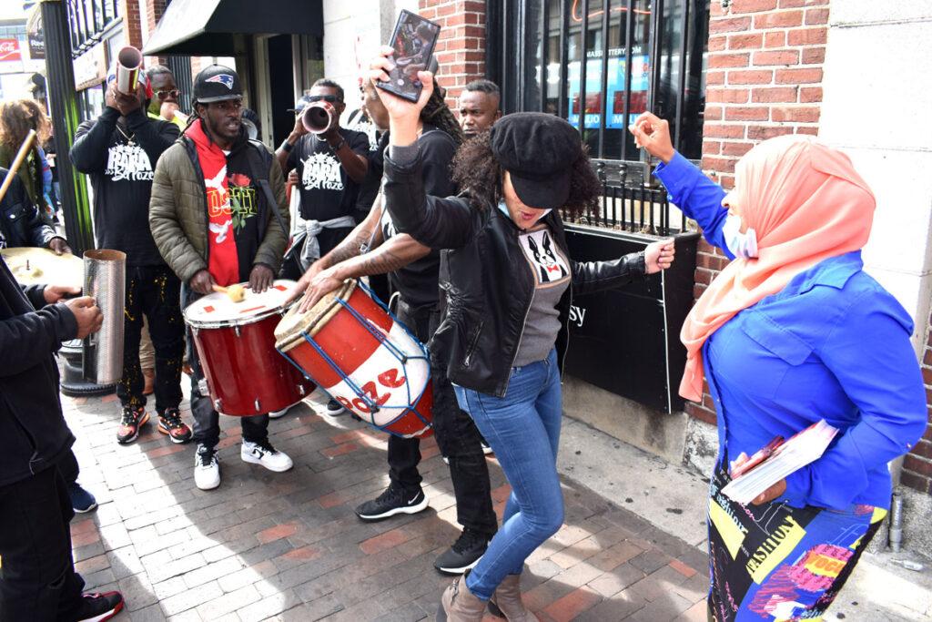 TRara Bel Poze plays in a procession through Nubian Square, Roxbury, Boston, Oct. 9, 2021. (©Greg Cook photo)ara Bel Poze plays in a procession through Nubian Square, Roxbury, Boston, Oct. 9, 2021. (©Greg Cook photo)