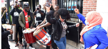 Rara Bel Poze plays in a procession through Nubian Square, Roxbury, Boston, Oct. 9, 2021. (©Greg Cook photo)