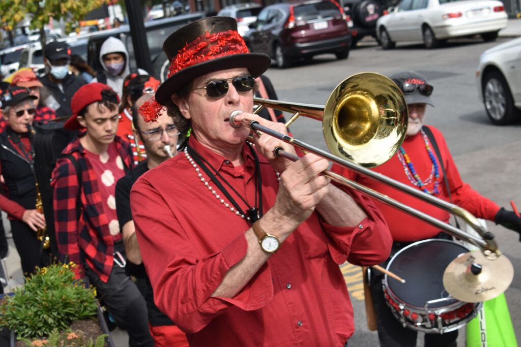 Second Line Social Aid & Pleasure Society Brass Band plays in a procession through Nubian Square, Roxbury, Boston, Oct. 9, 2021. (©Greg Cook photo)