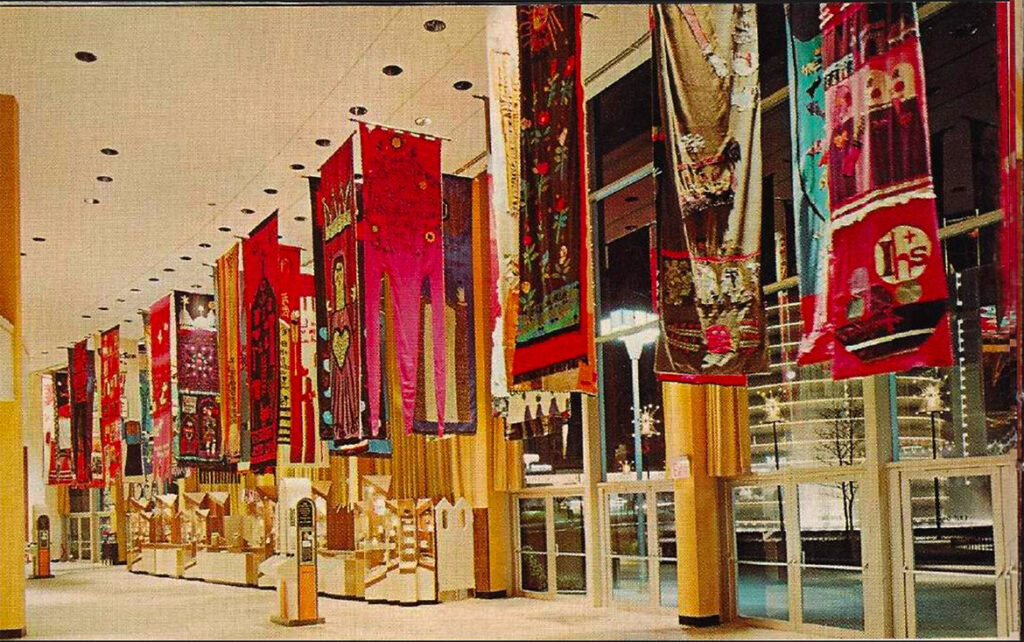 """Norman Laliberte's banners in the main concourse of the Vatican Pavilion at the 1964 to '65 New York World's Fair. (from """"Official Guide Book: Vatican Pavilion, New York World's Far 1965-1965"""")"""