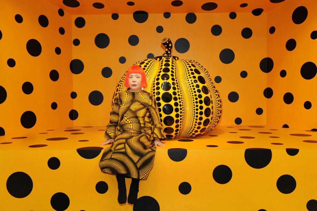 "Yayoi Kusama with ""Pumpkin,"" 2010. (Courtesy of Ota Fine Arts, Tokyo/Singapore/ Shanghai; Victoria Miro, London; David Zwirner, New York)"