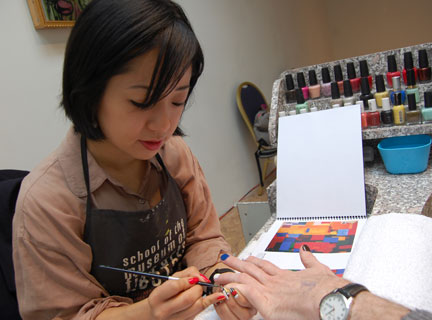 Victoria Shen paints nails